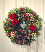 Christmas wreath, red roses and a purple ribbon