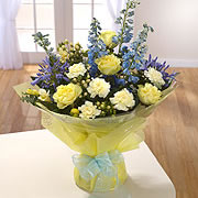 A bouquet of white and yellow roses adorned with Bluebells