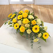 A basket, bouquet, of white and yellow roses with yellow daisies