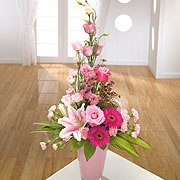 A vase, bouquet, of pink roses, purple daisies and pink, open, daffodils