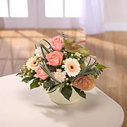 A bouquet of pink roses and large white daisies