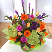 A bouquet orange and purple daisies, orange roses and purple Blazing-Stars