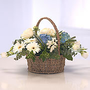 A baby blue basket, white and blue flowers