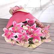 A bouquet of gift wrapped pink lillies