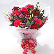 A bouquet of red and pink roses