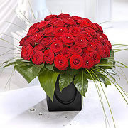 A bouquet of red roses, several dozen